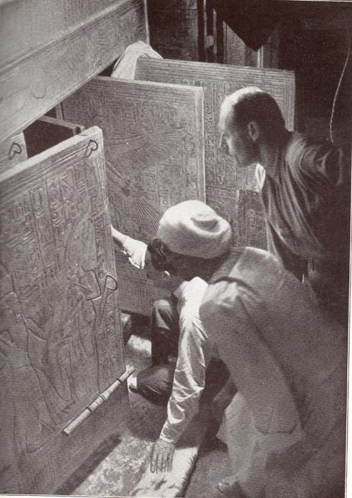 Howard Carter opening the doors of the tomb in 1922